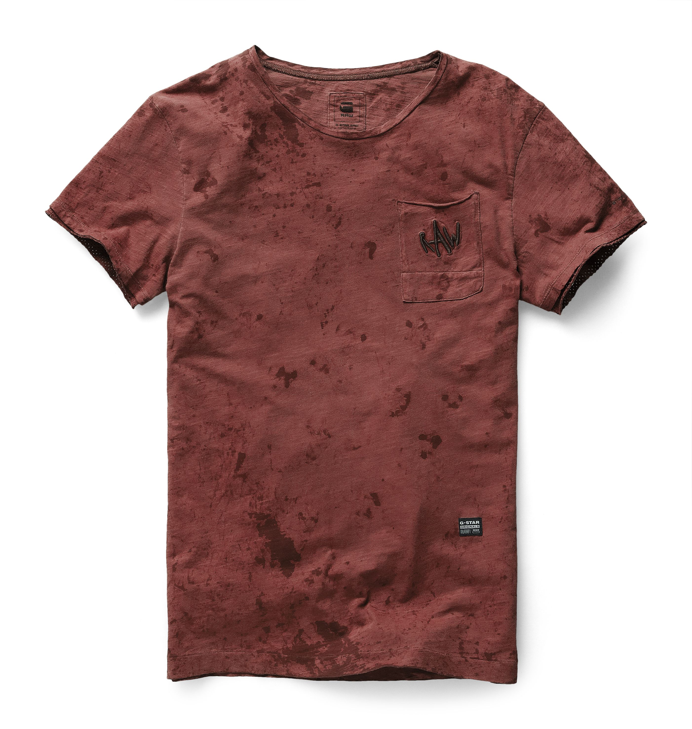 0fc9b1871c Round neck tee with a single patch pocket and raw-edge sleeves. The shoulder