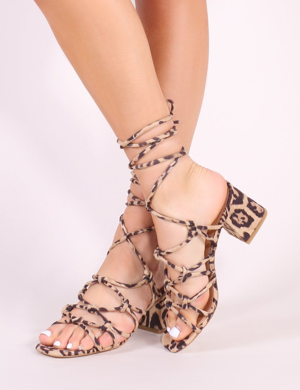 458f7083c00 Featuring strappy knotted design with a low block heel and lace up  detailing. Style with casual denim or a printed swing dress for warmer days.