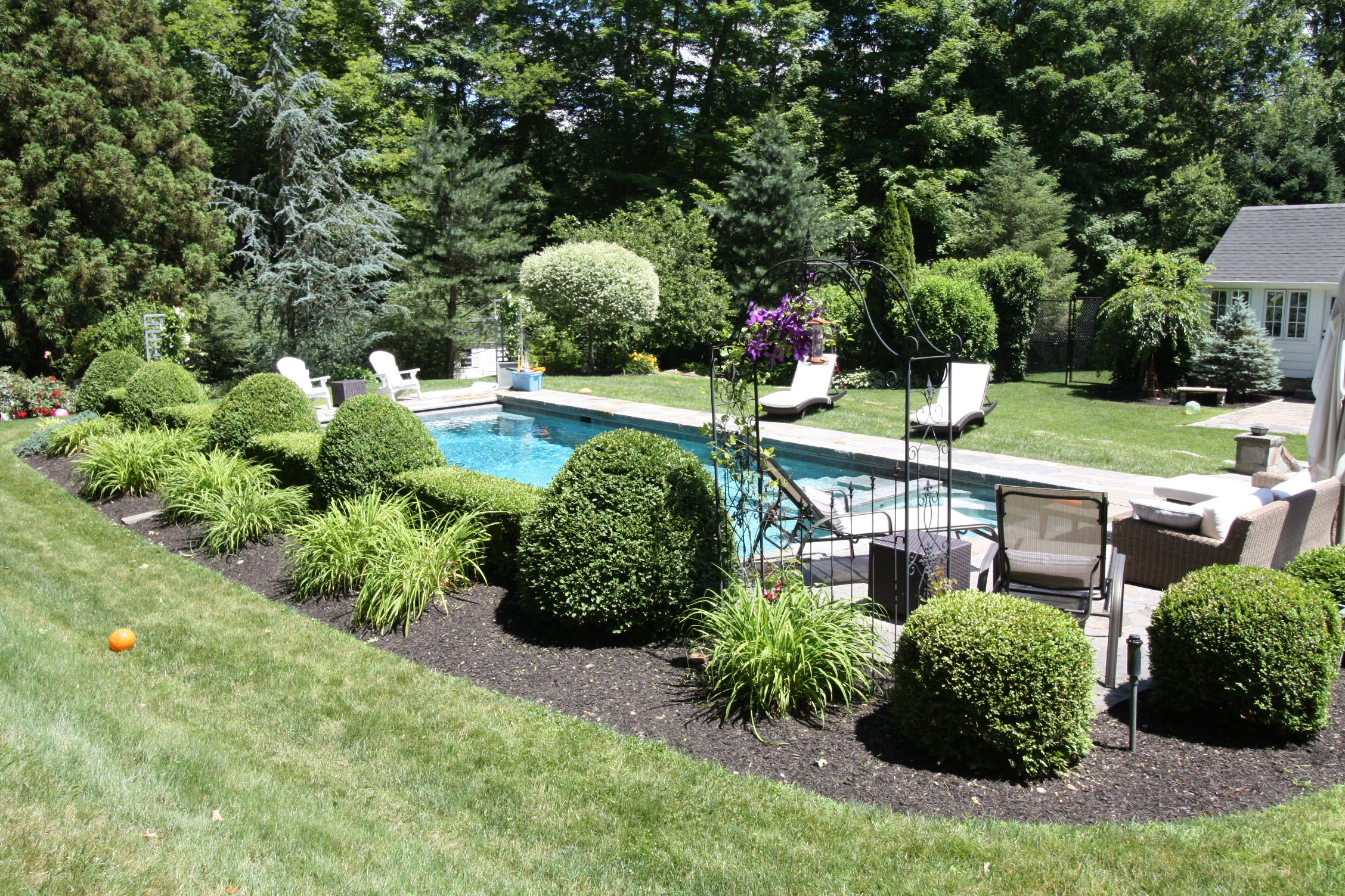 Did you know you can line your pool with a garden? At this home in Fairfield, CT we used a formal garden design to create beautiful aesthetics. #poolgarden #formalgarden #backyardbeauty #landscapes #gardendesign #poollovers #gardenlovers