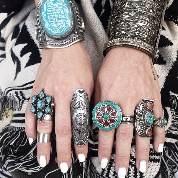 Heaps of, lots of jewellery and bijouterie, love rings and gemstones, gipsy style. Very fashionable! Bracelets make the hands feminine.