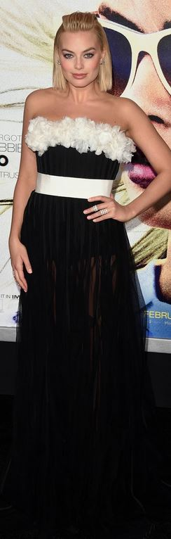 Who made Margot Robbie's black strapless gown, jewelry, and