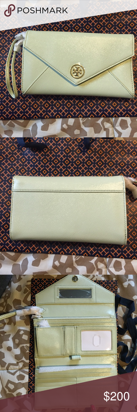 NWT-Tory Burch - Mint Julep color wristlet/clutch Mint Julep Colored Tory Burch clutch with wristlet handle for a ladies luncheon. Size- approximately 8 in. long and 5 in. Height. Fits a phone, check book, and has many pockets and slots for items along with mirror. Magnetic closure. Tory Burch Bags Clutches & Wristlets