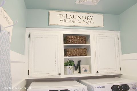 this is our 100 laundry room makeover that my husband and i completed just a couple, home decor, laundry rooms, How to paint laundry room cabinets a DIY tutorial