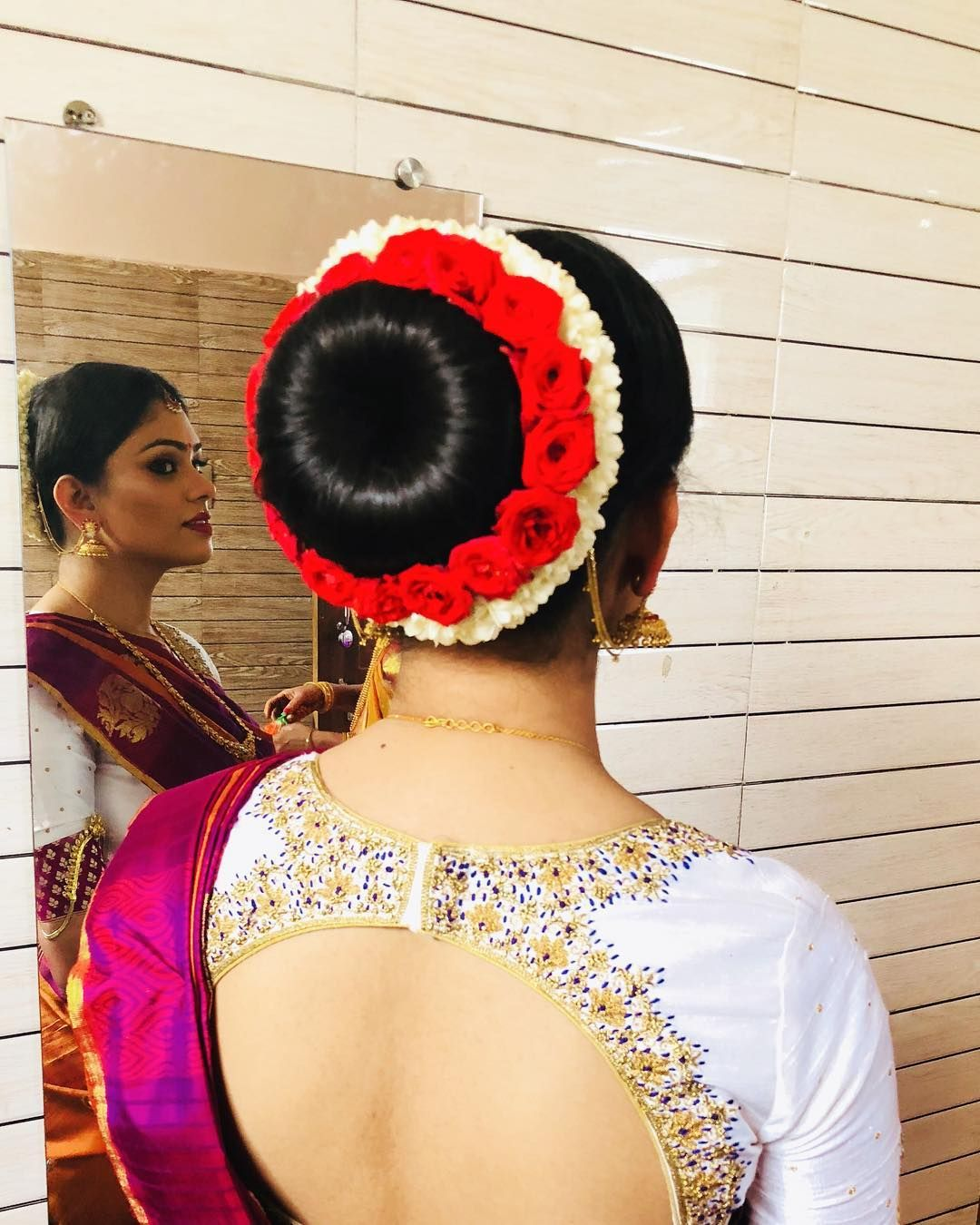 Perfect Bun With Rose N Jasmine On Her Engagement Day Bridalmakeup Bridalhairstyle Hairbun M Indian Wedding Hairstyles Bridal Hair Buns Bridal Hairdo