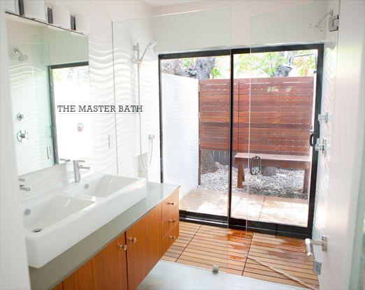 Indoor Shower With Sliding Doors To An Outdoor Shower