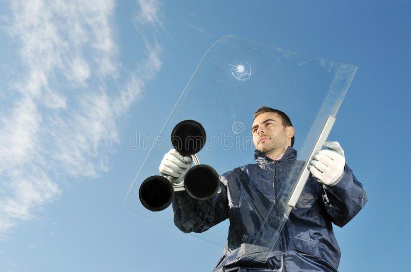 Autoglass. Man replace broken auto glass ,