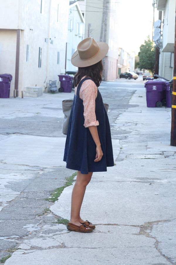 Oversize blue jumper and chiffon blouse with rolled sleeves.