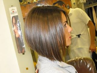 This is my hair cut now. I like it both straight and curly. I wear it curly a lot since I have a newborn and hardly any time to get ready. Easy, easy hair cut. :)