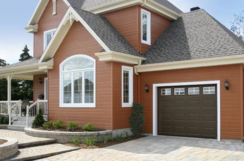 This Traditional Raised Panel Clopay Steel Garage Door In Chocolate  Coordinates Nicely With The Warm Color