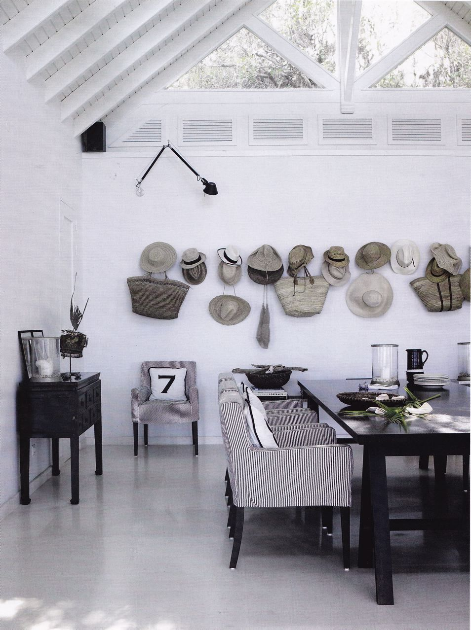 Have a walk in closet with one wall for hanging bags like these you