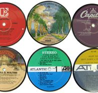Awesome Record Coasters by Vinylux.  Made from repurposed LP's.