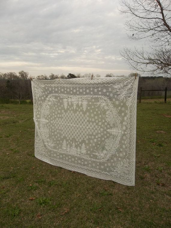 Need a Chuppah? Use a vintage tablecloth to save money and get that great vintage feel.