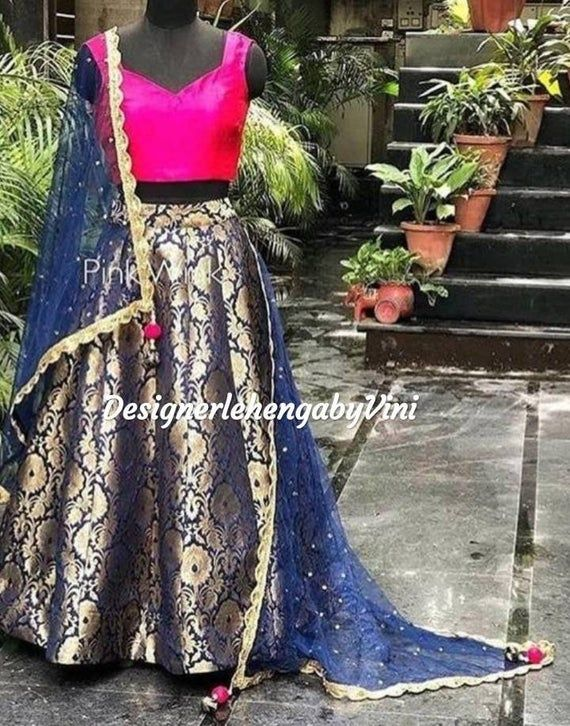 All size availableContact for size availabilityExtra charges for plus sizes from 3XL to 5XLFabric details-Top- taffeta silkSkirt- pure banarasi brocadeDupatta- NetMessage for size chart.