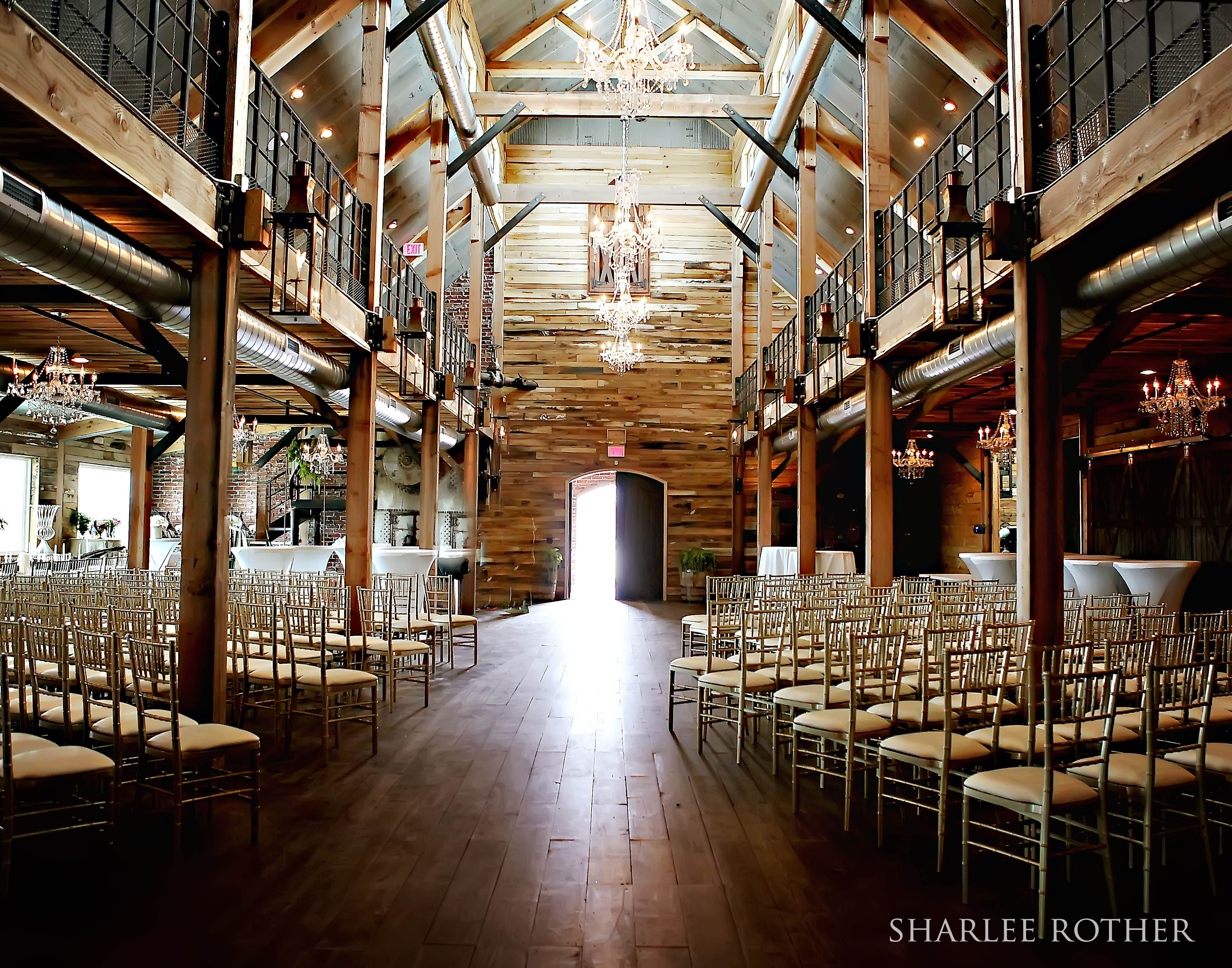 The wedding aisle includes 72 feet of custom 3 foot tall gas the wedding aisle includes 72 feet of custom 3 foot tall gas lanterns and luxurious glass and crystal chandeliers wedding venue oklahoma junglespirit Images