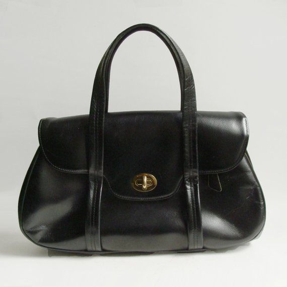 And Old Black Leather Handbag With Handles A Gold Clasp Was Of Vital Importance In Oscar Wilde S The Being Earnest