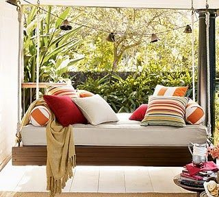 Hanging day bed. I could easily waste a day lounging reading a book here.