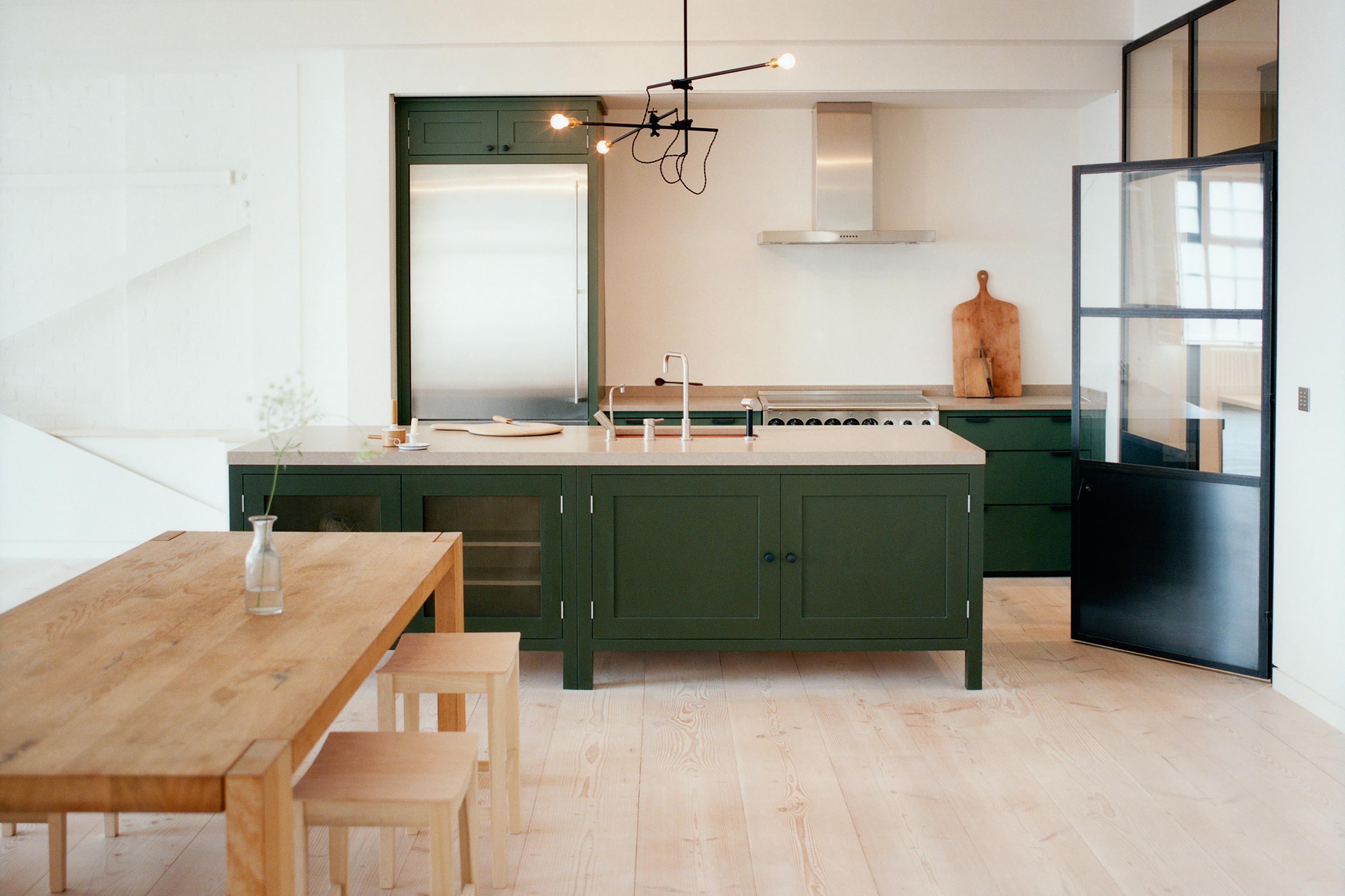 Modern kitchen with dark green and wooden furniture kitchen