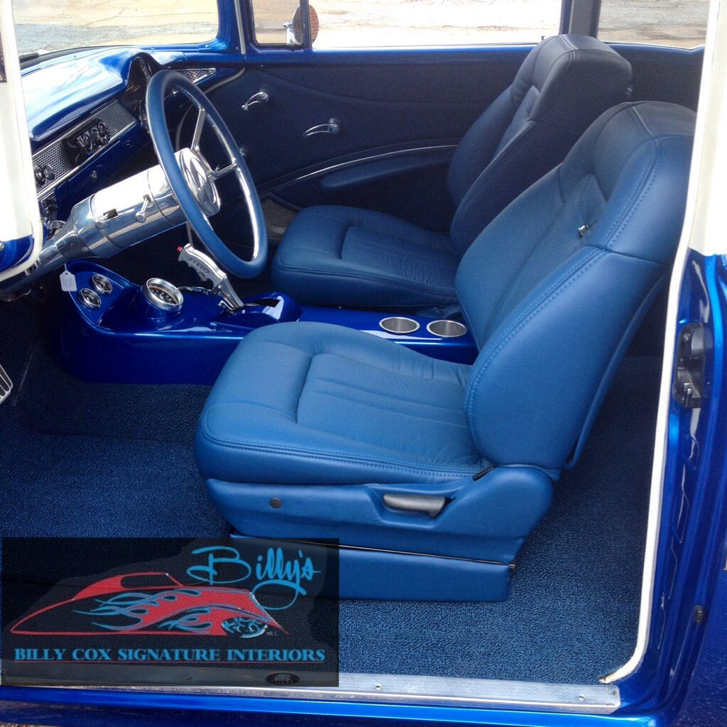 Custom interior we just completed. 55 Chevy with blue leather and polished aluminum trim