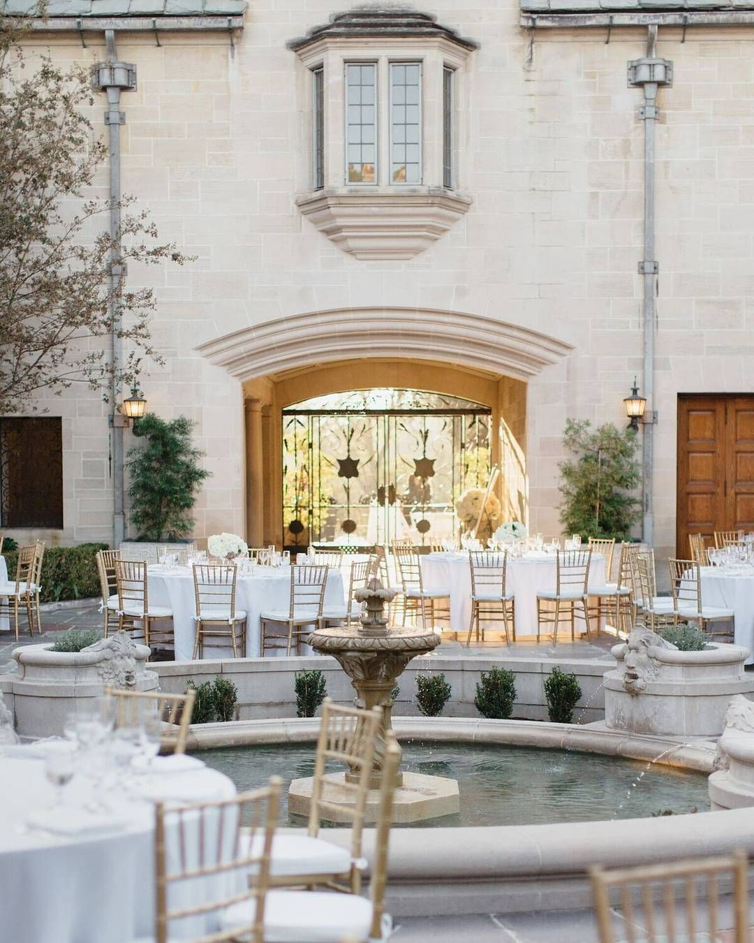 This white and gold courtyard reception used simple decor