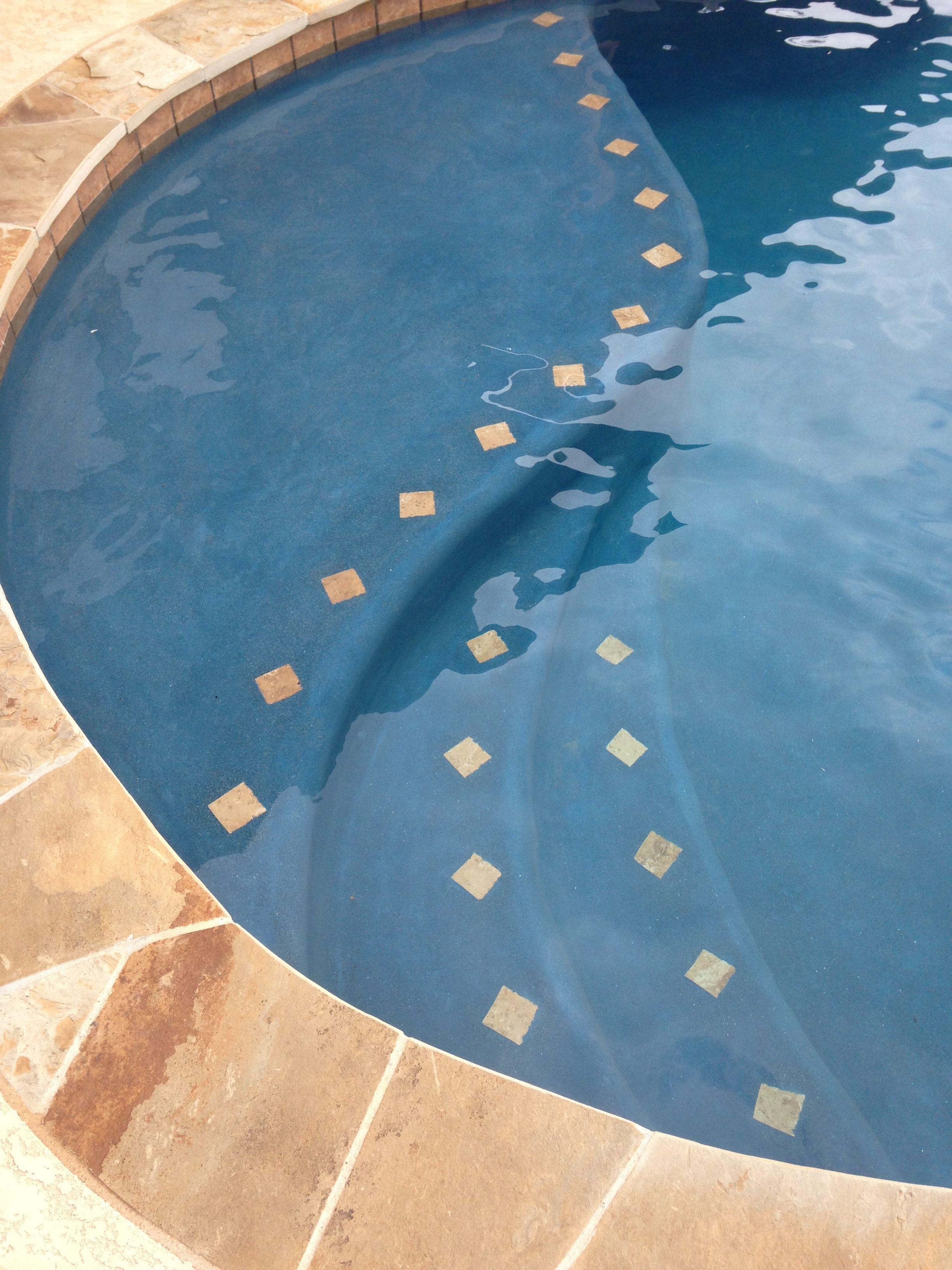 inground swimming pool small tanning ledge flagstone coping