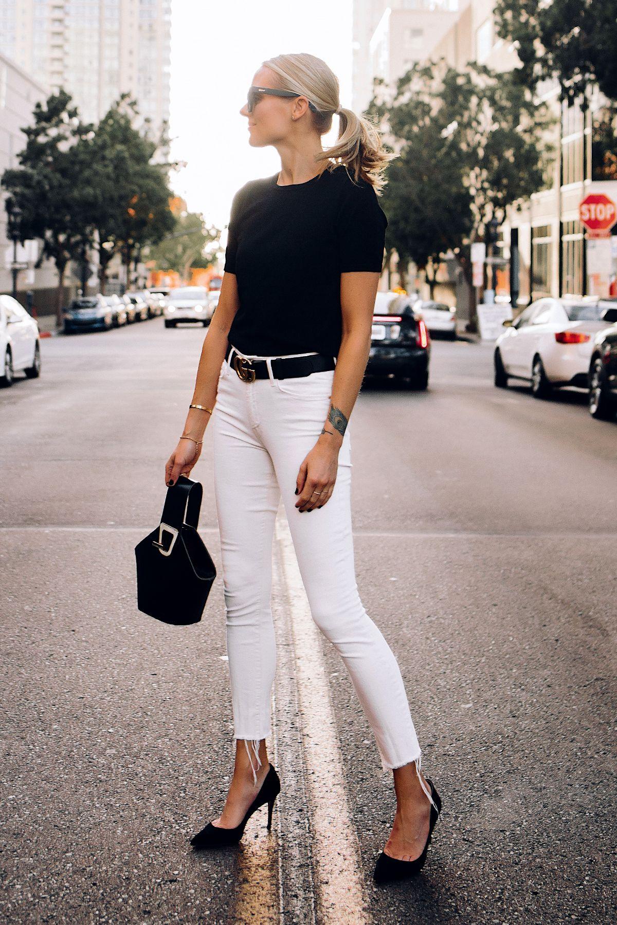 7bec875ecf6 Woman Wearing Black Short Sleeve Sweater Raw Hem White Skinny Jeans Black  Pumps Black Gucci Belt Black Bucket Bag Fashion Jackson San Diego Fashion  Blogger ...