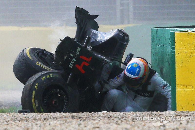 Fernando alonso mclaren mp431 exits his car after a huge