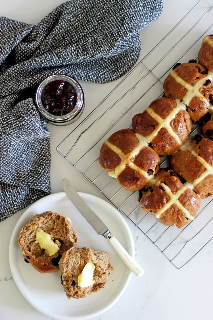 Fruity, spicy delicious homemade hot cross buns! Step by step photos and instructions to help you make the perfect Easter buns this year! Or any time of year! #thekiwicountrygirl #easter #hotcrossbuns #bread