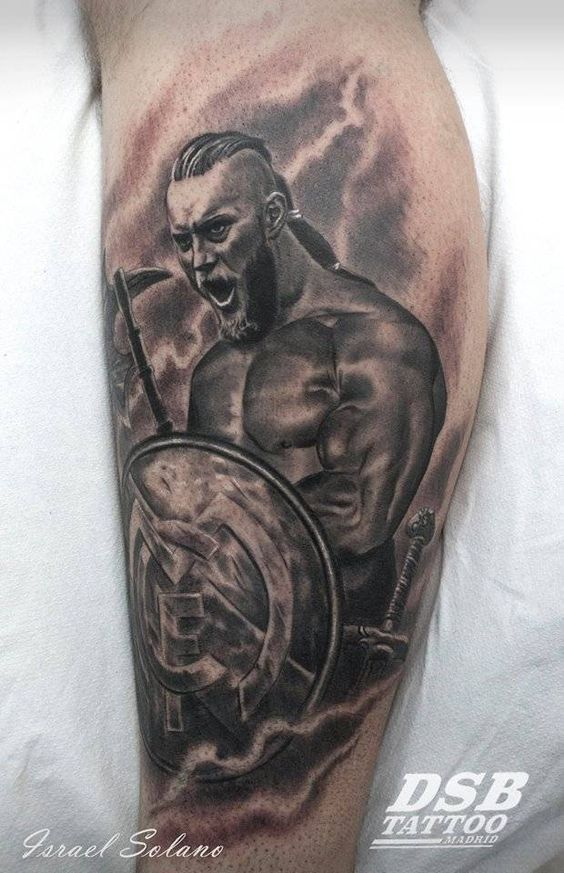 Black And Grey Style Ragnar Lodbrok Holding A Real Madrid Shield