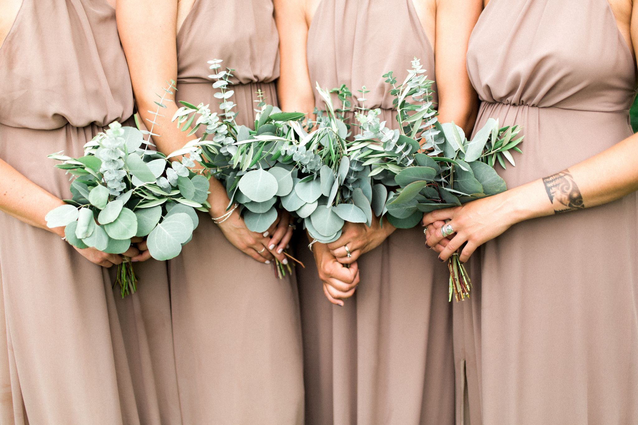 Eucalyptus wedding bouquet with light tan/neutral bridesmaid dresses. Michigan greenery wedding bouquet made by Ludema's floral. #weddingbridesmaidbouquets