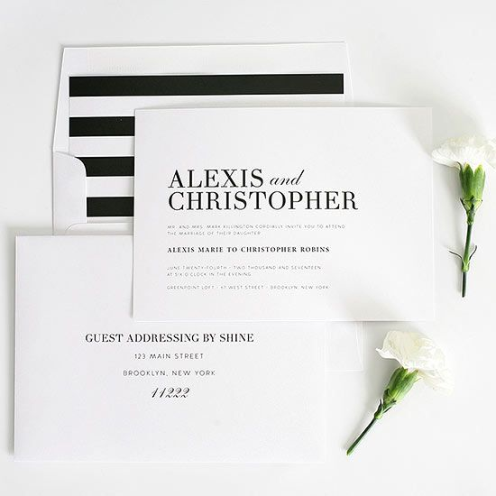 Say it with stripes. Bold stripe-lined envelopes add interest to these glamorous black-and-white invitations. Complete the look with coordinating table numbers, thank you cards, and menus.