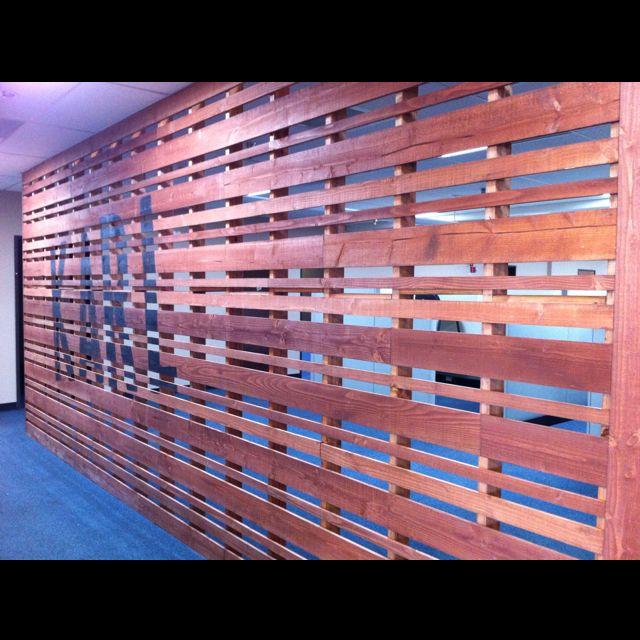 Wood Slat Wall With Stencil Art. Office Hallway.