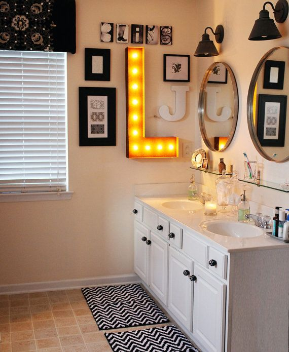 """Lighted @ symbol. Maybe the """"founding 7"""" can go here. Each person can pick a different frame and fill it with something that represents them? #home #bathroom #deco"""