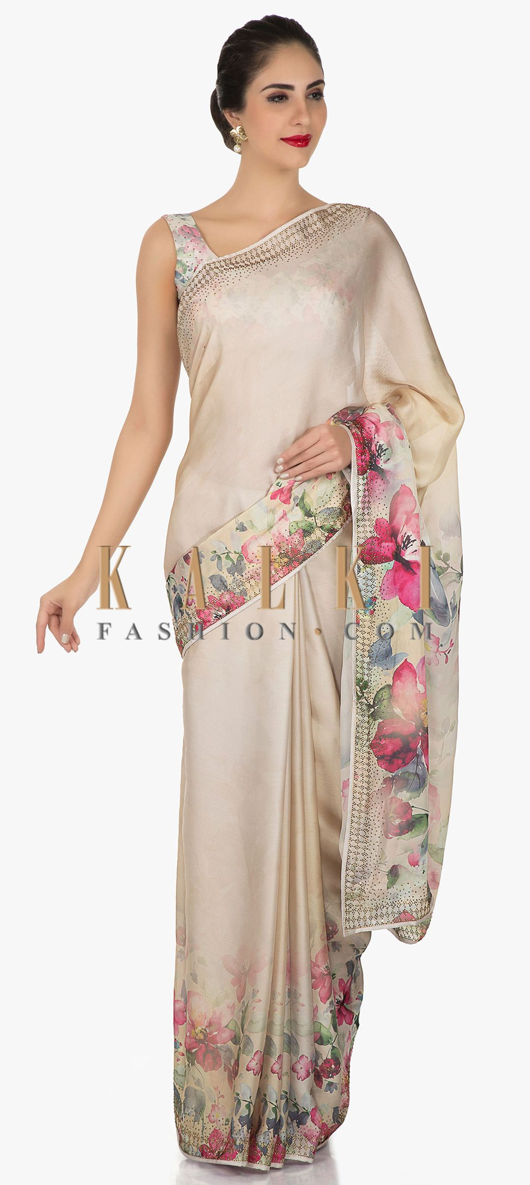 1e61c714c9 Light beige saree in satin enhanced in kundan and floral print only on Kalki
