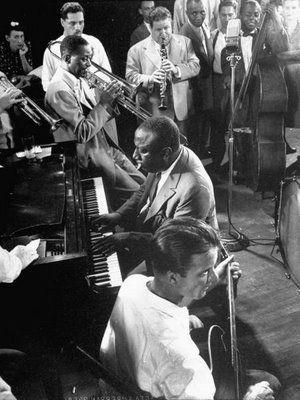 James P. Johnson, piano, Irving Fazola, clarinet, Wilbur De Paris, trombone, Franz Jackson (behind De Paris), saxophone, Al Mott, bass, Eddie Condon (foreground), guitar, 1943