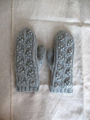 Gorgeous mittens made by cocoknits. A modification of the free Regina Cable & Bobble Fingerless Mitts by SmarieK