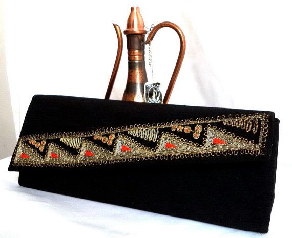 Hey, I found this really awesome Etsy listing at https://www.etsy.com/listing/240009652/50s-yemenite-israel-clutch-bag-vintage