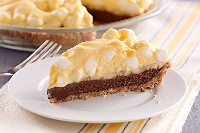 Layer chocolate, fresh bananas and airy pudding in a pecan crumb crust for a delicious banana pie and then chill for blissful perfection. So sweet! #bananapie