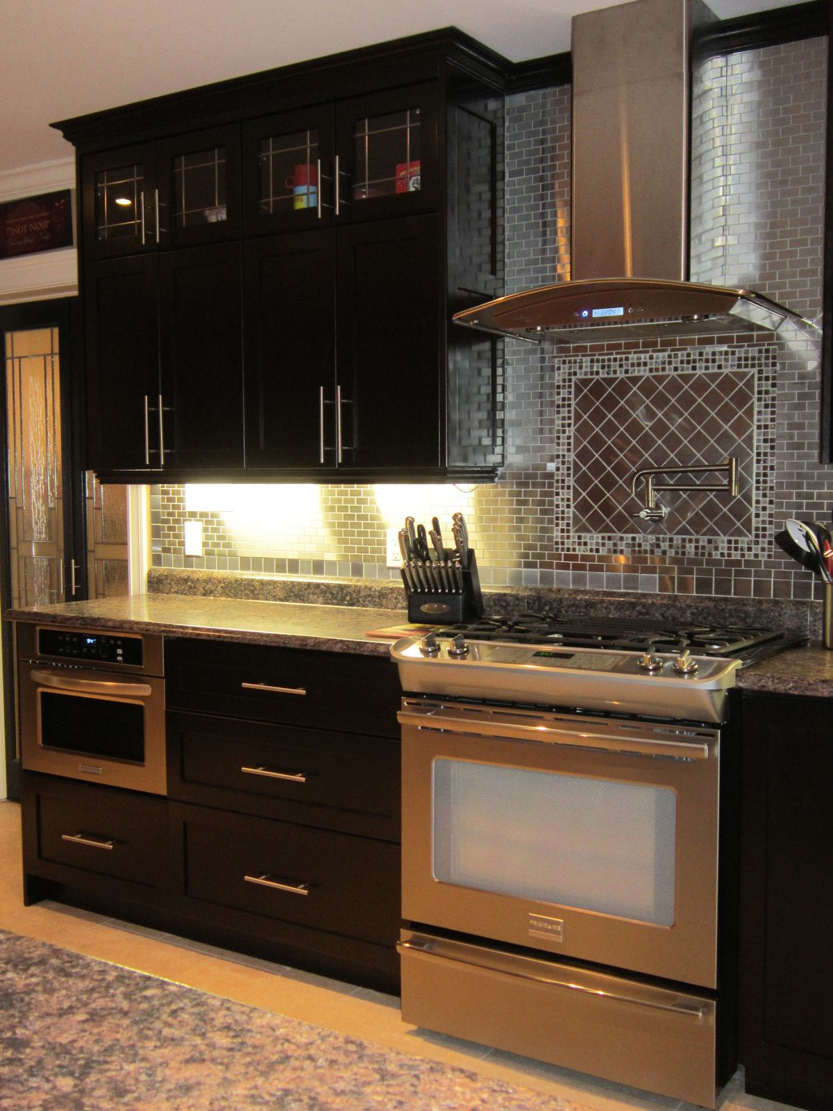 Potfiller faucet in next house too AND the KitchenAid microwave ...