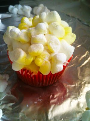 think fruitful: Cupcakes topped with popcorn made from marshmallows- Great for a movie-themed party!