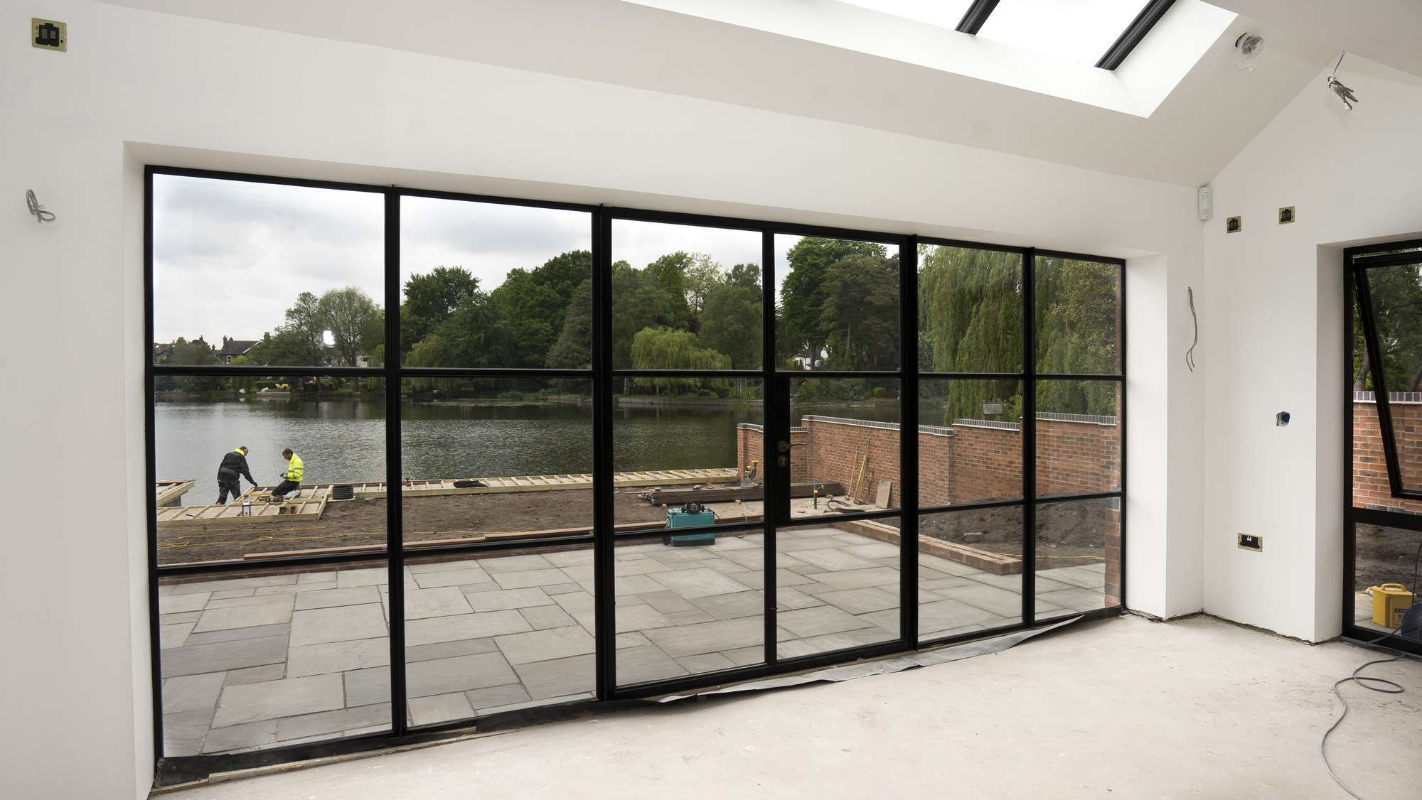 Internal View Of Large Crittall Screen In Black With Opening Doors And Sidelights In 2020 Crittall Patio Doors Sliding Patio Doors
