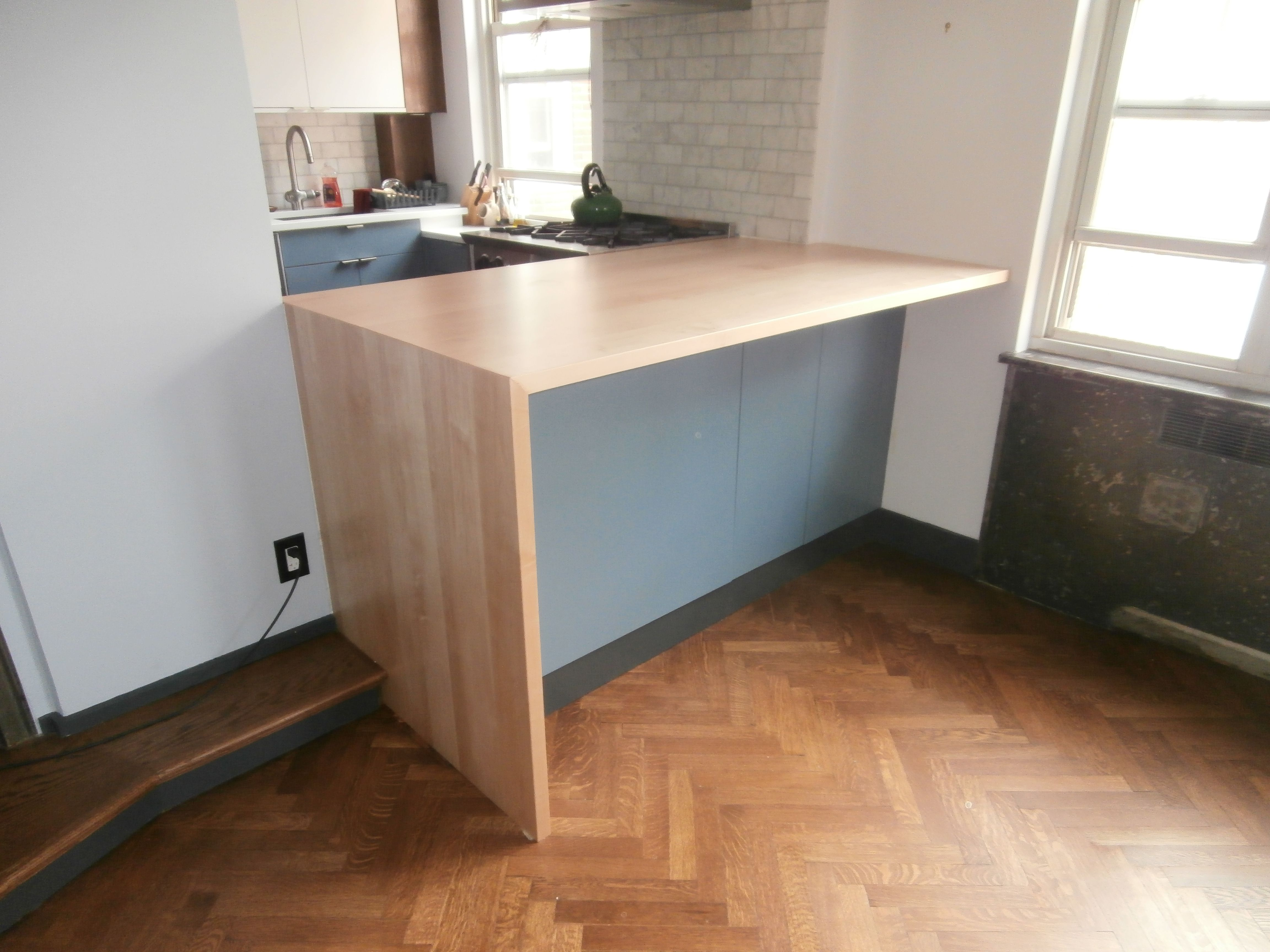 standard plank maple countertop with waterfall edge detail
