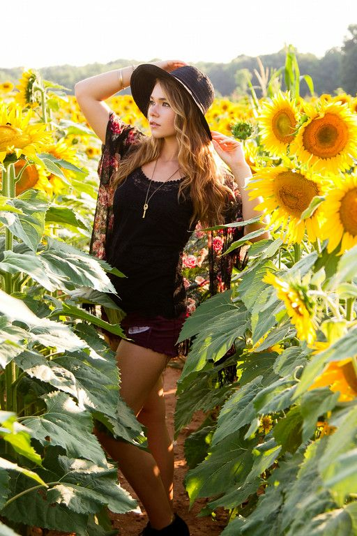 Bohemian senior session using a sunflower field as a