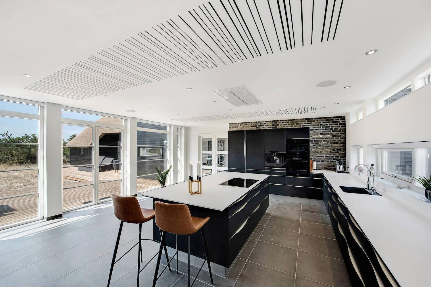 Inspiring contemporary bright barn style house located in Blåvand ...