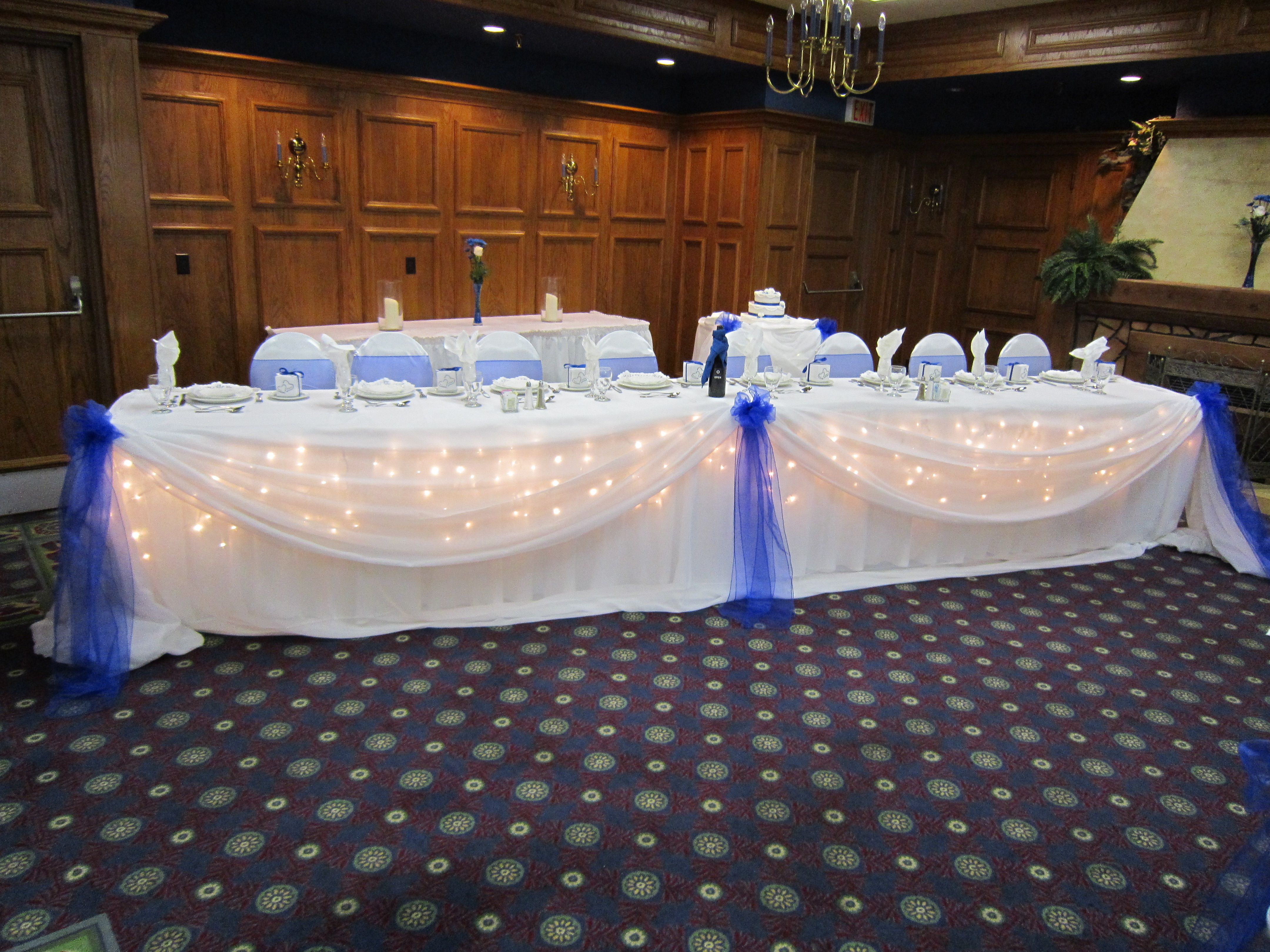 Head table with icicle lights | Set The Mood Decor