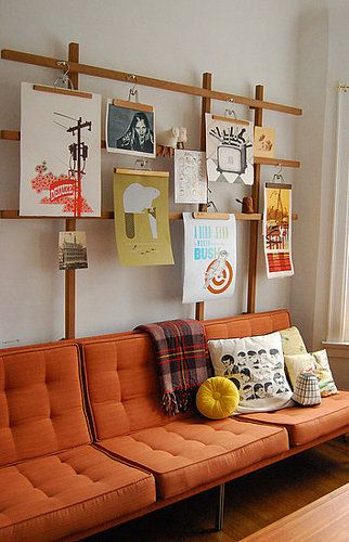 Pant hanger turned picture hanger, and a great orange couch!