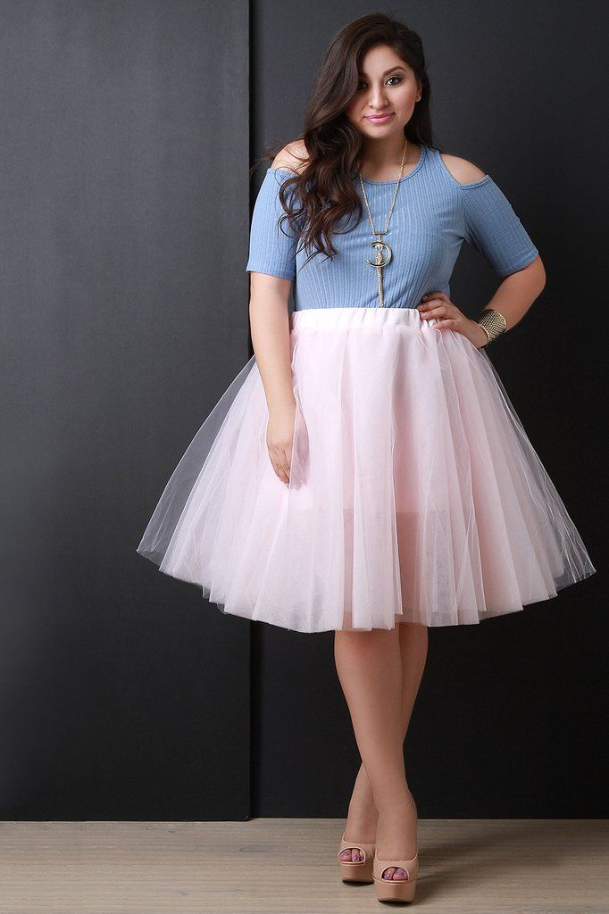 a1f9629241a This plus size semi-sheer knee length skirt features layers of tulle and a  wide…
