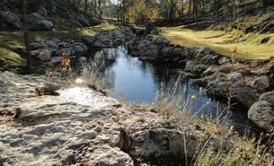 We designed and created this creek for a client who wanted water on his property. This was originally a silt-filled, muddy ditch at the bottom of a canyon in Wimberley, TX. See more of our projects at www.lakesponds.com.