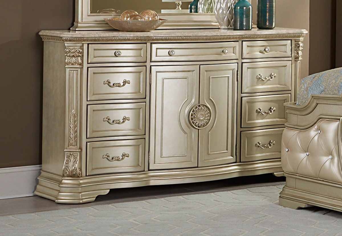 Traditional wooden dresser with marble top champagne gold in
