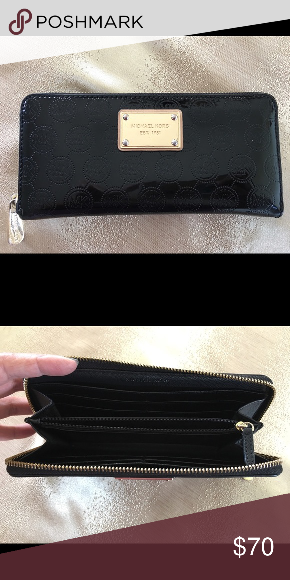 5c4721041c2e Michael Kors Zip around Wallet Gently used patent leather, black wallet.  Accessories