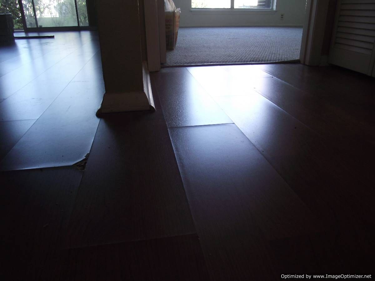 Wet Laminate Flooring Before Repair This Photo Is Dark In Order To